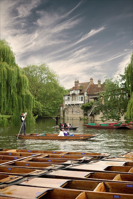 Punting on the River Cam in Cambridge, England // Punts were originally built as cargo boats or platforms for fowling and angling, but in modern times their use is almost exclusively confined to pleasure trips.