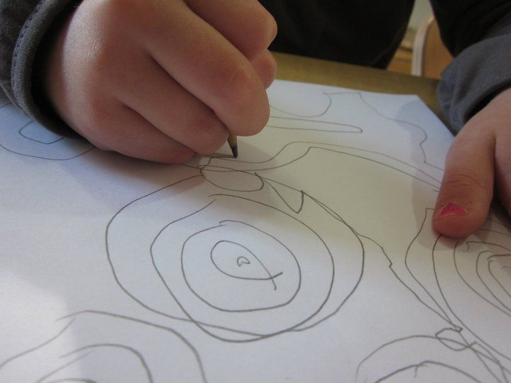 Thick question: What is the significance of spirals in the child's visual representation? Thin question: What is the child representing?