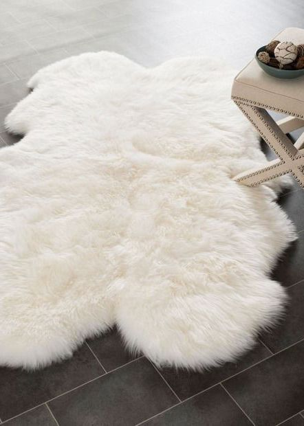 Obsessing over this white faux sheepskin rug that goes perfect in a baby room, living room, as a couch decor or even in your bedroom