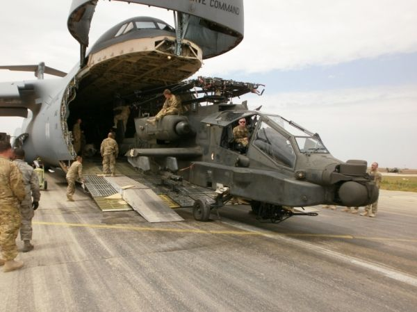 Soldiers from 12th Combat Aviation Brigade, out of Ansbach, Germany offload an AH-64 Apache helicopter from a C5 Galaxy cargo aircraft in Mazar e Sharif, Afghanistan on 28 April, 2012, I was with the 211th with them during my deployment.