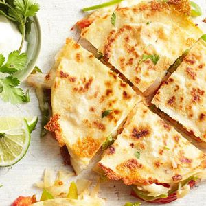 Vegetarian quesadillas--Hot and savory, Serrano chiles lend their signature kick to these amazing vegetarian quesadillas, inspired by the flavors of classic fajitas. When buying bell peppers, choose that are firm, heavy for their size, and have shiny, vibrantly-colored skin.