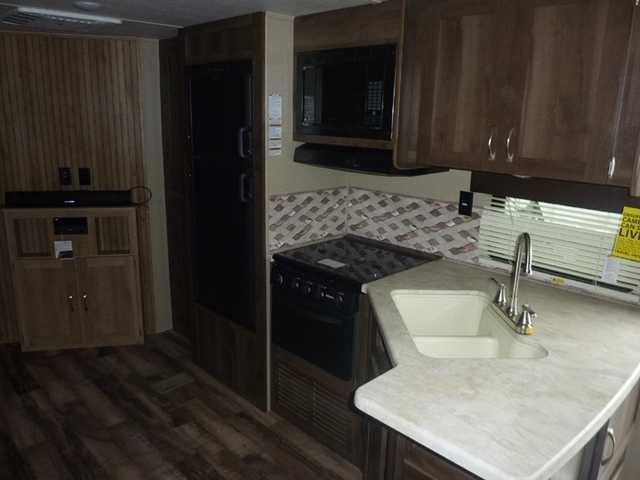 2016 New Palomino Puma 27RLSS Travel Trailer in Ohio OH.Recreational Vehicle, rv, OWN THIS UNIT FOR ONLY $211.63 per month w/ approved credit! This New Lay-Out features a rear lounge w/ a side aisle bathroom, Glass Shower, and a Couch/Dinette Slide-Out and only weighs 6,405lbs! This Trailer is equipped Cream Colored Aluminum Siding, ducted 13,500BTU A/C, Power Awning, LED Lighting throughout, Microwave, TV Antenna, AM/FM/CD/DVD Stereo w/ Soundbar and Exterior Speakers, Double Door…