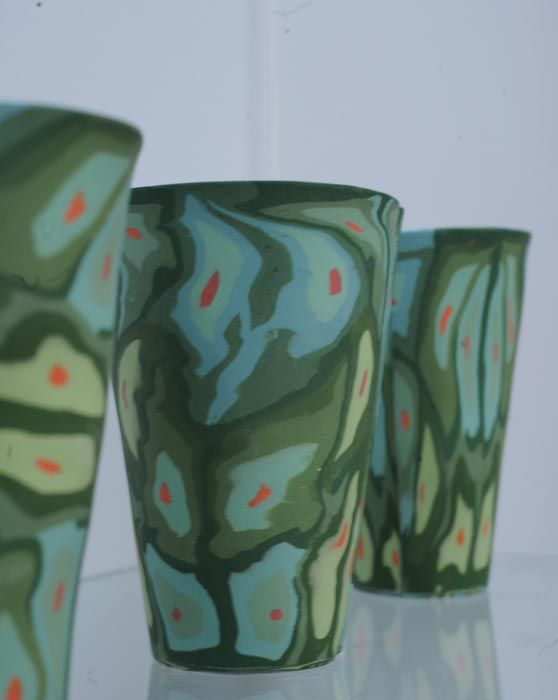Latte cups by Nanna Bayer. Handbuilt porcelain, colored clay inlay or nerikome/neriage techniques.