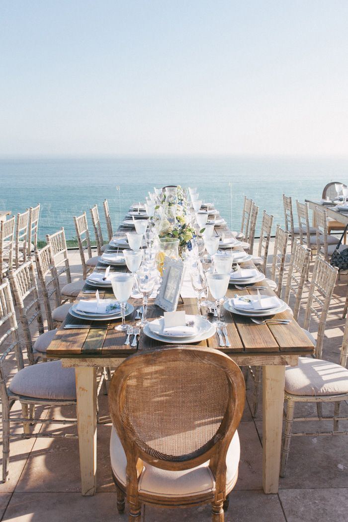A rustic farm-table for a seaside wedding reception. #beach #wedding
