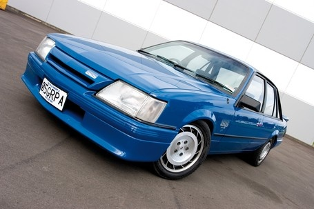 1984 Holden Commodore VK Group A aka 'Brocky', 'Bluey'. 5.0L V8 race car spec. 196kW and 418nM. 0-100km in 7 seconds. Only 500 were supposed to be made. Due to a mix up, 502 were completed.
