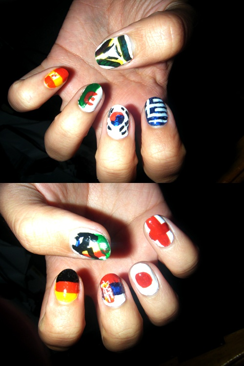 The nails I did for the World Cup in 2010. These took me something like 3+ hours. The flags are Spain, Algeria, South Korea, Greece, Germany, Serbia, Japan, and England, with the official soccer ball pattern on one thumb and the logo on the other thumb. I'm never doing anything this complex again.