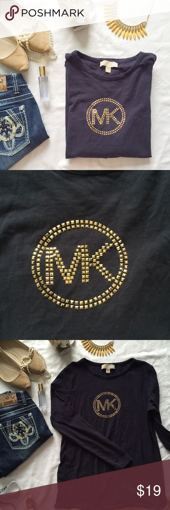 "Michael Kors long sleeve navy/rose gold tee Beautiful basic long sleeve tee with rose gold colored studs (none are missing). I love long sleeve tees in the fall!! Gently used, but in great condition! Measurements (laying flat): bust 20.5"", length 27"", arm 24"" Michael Kors Tops Tees - Long Sleeve"