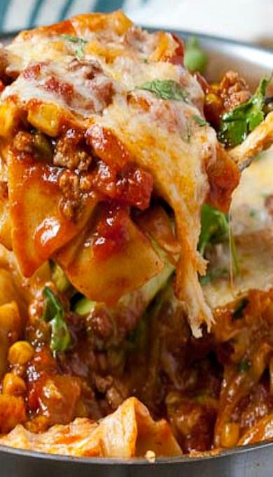 This lasagna delivers a one two punch of spicy flavor and healthy, fresh ingredients. It's packed with bell peppers, tomatoes, jalapeno, and corn, and finished with diced avocado and cilantro.