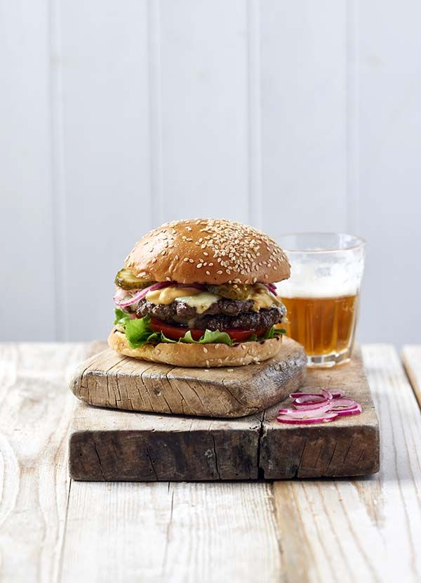 The full works burger. We like our burgers piled sky-high with 'the works' – that means EVERYTHING including our secret sauce (made from four very simple ingredients), sweet and sour onions, emmental cheese, gherkins, frilly lettuce, and more ...
