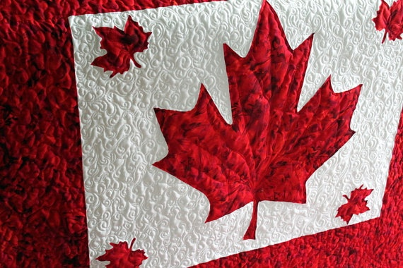 Beautiful Patriotic Quilt proudly displays the Canadian Maple Leaf.    source:  Etsy