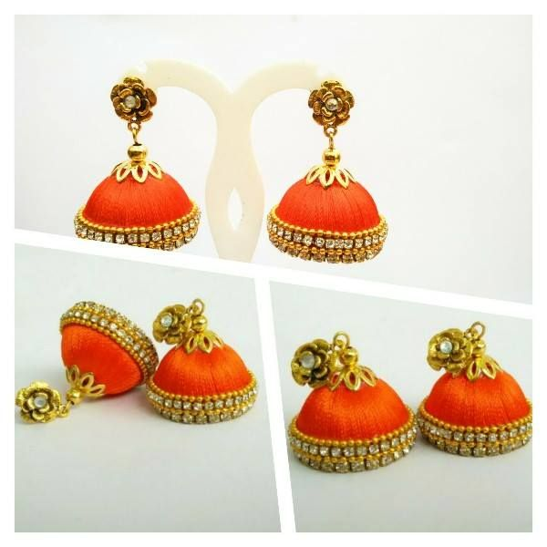 a very beautiful silk thread jhumka  , embelished with stones and gold beads.. perfect for any occassion...