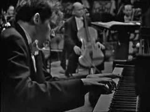 """Glenn Gould : Bach - Keyboard Concerto No.1 D minor BWV 1052 - Glenn Gould with Leonard Bernstein and the New York Philharmonic [1960]  Excerpt of the first movement, Allegro.  Taken from """"The Art of Piano"""" DVD. If watching this doesn't get your blood moving you must be dead."""