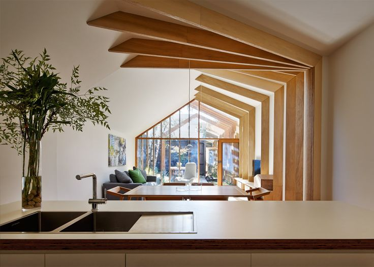 """FMD Architects used slender lengths of timber to """"stitch"""" together this narrow Melbourne house and its new garden extension"""