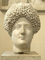 Domitia Longina (c. AD 53-55–c. CE 126-130) was an Empress of Rome and wife to the Roman Emperor Domitian. She was the youngest daughter of the general and consul Gnaeus Domitius Corbulo. Domitia divorced her first husband Lucius Aelius Lamia in order to marry Domitian in 71.