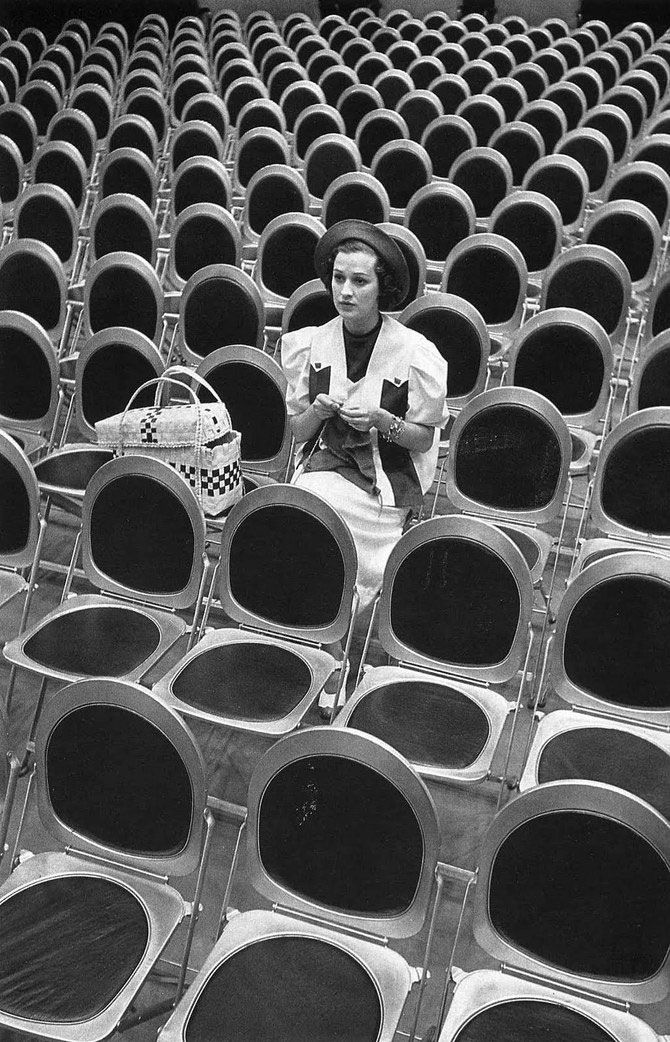 Alfred Eisenstaedt: Singer Jane Froman Knitting in Empty Studio Audience Chairs During a Radio Broadcast Rehearsal 1938