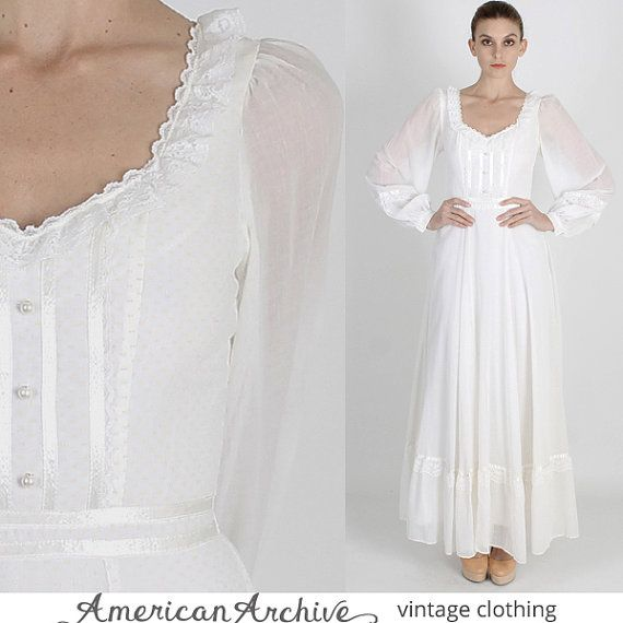 I have this idea for a floor length dress, with full, voluminous sleeves, in a very light-weight material. In creme or white. Instead of this neckline I would do a lacey, fitted turtleneck-ish(?) thing, and I would want the skirt to be a little longer.