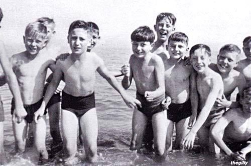 "John Lennon on a Dovedale Primary School trip to the Isle of Man in the summer of 1951. To the right of him in the picture are Jimmy Tarbuck, Mike Hill and wee Ivan ""John, I'd like you to meet Paul"" Vaughan."