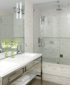 Toronto Loft - Neutral wall tiles, a leggy vanity and a glass shower enclosure add up to a light, open feel. by andi ogden