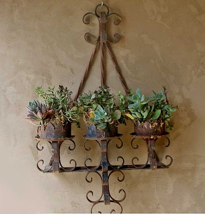 pillar candle holder....great for succulent cuttings and more decorative than potting shelves...look nice on fence