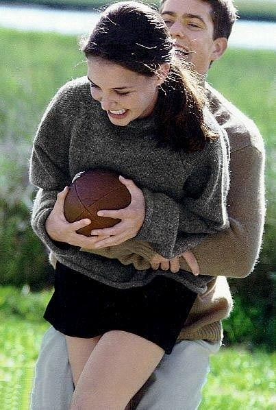 Joey holds onto a football for dear life as Pacey performs the Heimlich maneuver.