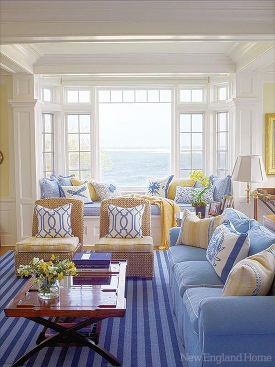 Beachy blues with sunshine yellow accents make a pretty living room