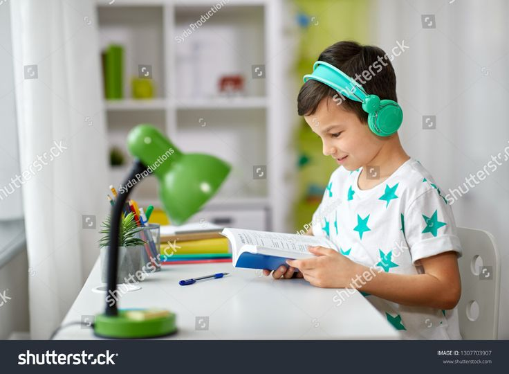 education, childhood and technology concept – happy schoolboy in headphones reading book at home #Ad , #AD, #concept#happy#technology#education
