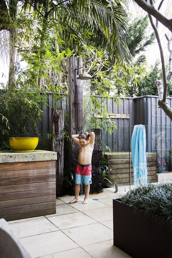 Outdoor shower. The support post is made from a recycled railway sleeper.