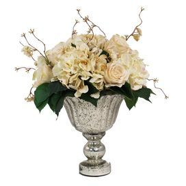 "Add a touch of natural appeal to your credenza or console with this lovely faux floral arrangement, showcasing roses and hydrangeas in hues of crisp white and delicate cream.   Product: Faux floral arrangementConstruction Material: Silk, plastic and silverColor: White, cream and silverDimensions: 21"" H x 22"" W x 17"" D"