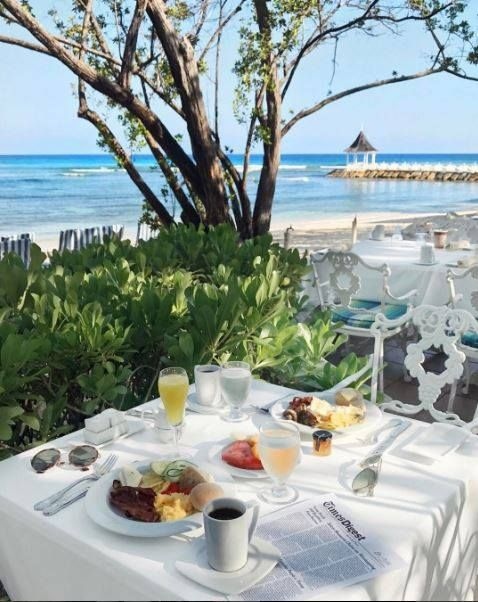 Romantic vacations mean breakfast for two with breathtaking ocean views. Thanks to Wishbone & Clover for this shot at Half Moon Jamaica.