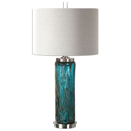 Alluring hand crafted Blue Glass Lamp spun with bronze sugar accents, and finished with elegant brushed nickel plated details.