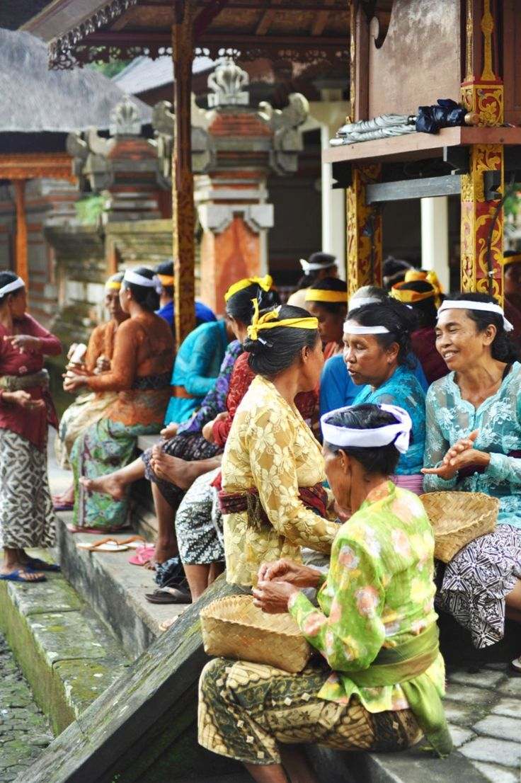 Balinese women preparing offerings for a religious ceremony. Since their very young age, Balinese girls have been actively involved in the preparation of offerings for religious ceremonies, starting with those at family temples then at bigger, public ones, from the simplest to the most intricate flower offerings. Taken by my son @andrewarismunandar, September 2010.
