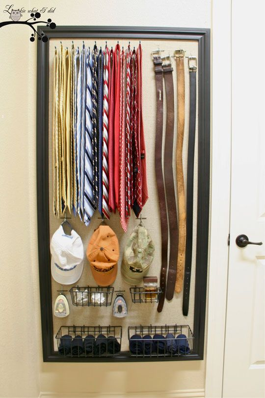 Make your own organizational panel with a peg board fabric and a frame. Very nice for small living spaces.
