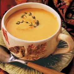 Butternut Squash Soup Recipe -This deep golden soup is as pretty as it is yummy. If you'd like, you can intensify the garlic flavor by adding an extra bulb. The garlic is what really flavors this soup. -Linda Rose Proudfoot, Huntington, Connecticut