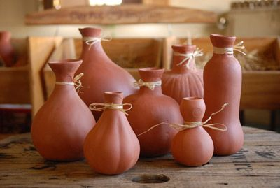 Clay pots called Ollas - an ancient drip irrigation technique - not to be used near shrubs or trees (root rot could occur).