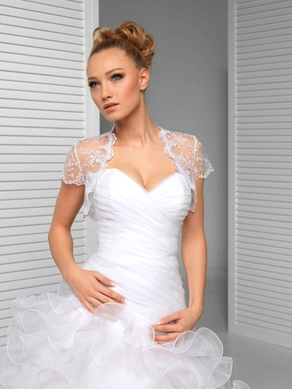 This feminine lace top makes a gorgeous addition to your strapless wedding dress. Beautiful lace top is pure and unique, made with care to every