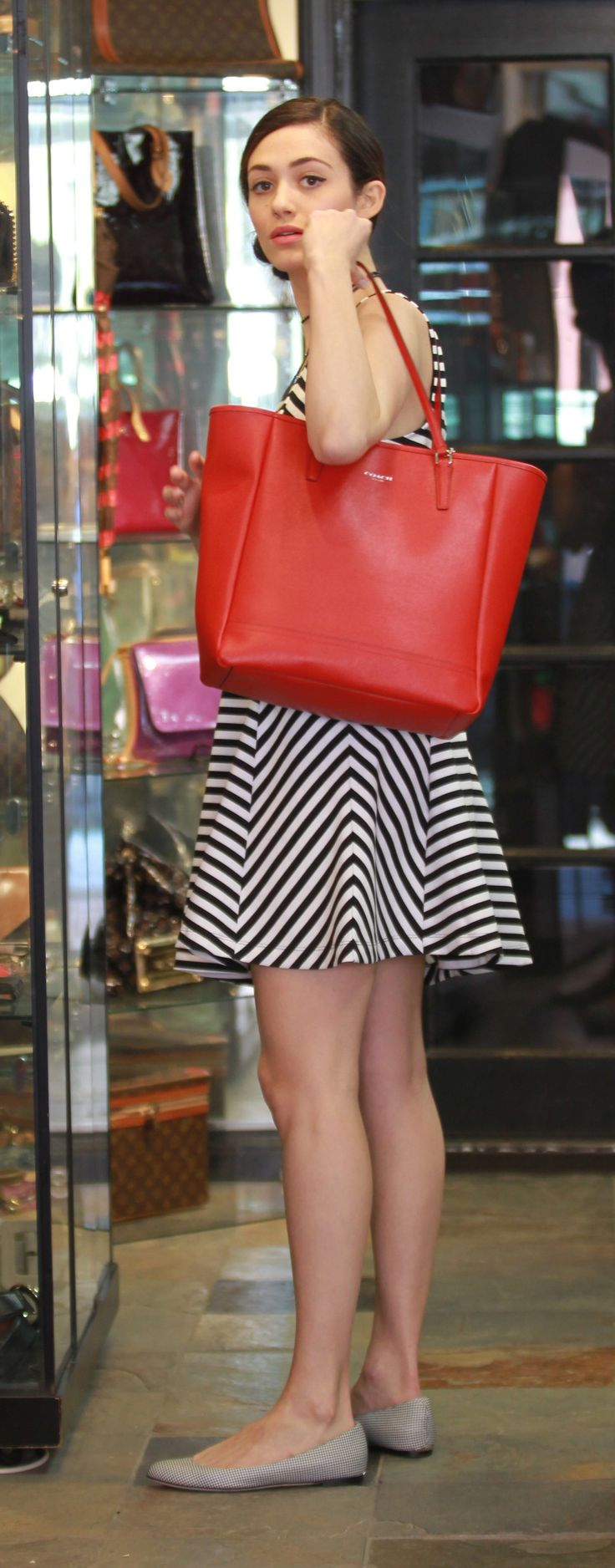 Spotted wearing Coach: Emily Rossum with the Saffiano North/South City Tote. Image Courtesy of Splash News.