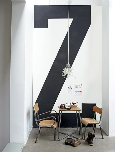 large letter painted on a narrow wall