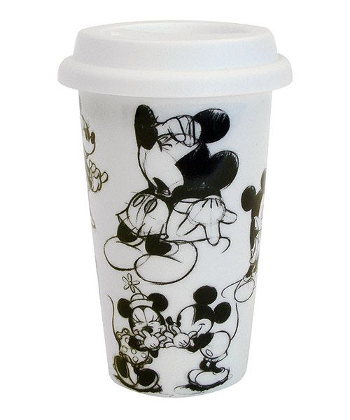 Double-walled to keep hot drinks hot and cold drinks cold, this ceramic travel mug boasts a magical Disney-inspired design and a coordinating lid for spill-free sipping.Holds 10 oz.Ceramic / plasticMicrowave and dishwasher safeImported