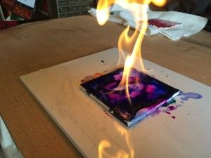 """""""Painting with Fire!"""" by Carlee. One of the draws of alcohol ink is its looseness and unpredictability–so what if we amplified that and added a little danger? This week's project was inspired by a video I saw on YouTube where an artist applied alcohol inks to a ceramic tile and then lit it on FIRE! #ArtBlog #ArtLessons #AlcoholInks"""
