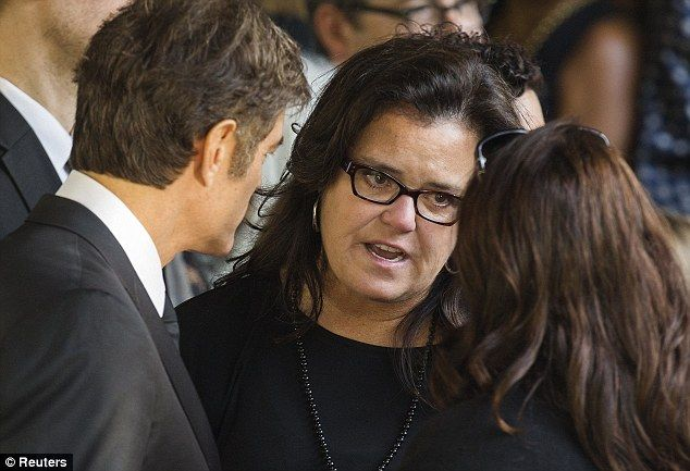 Comedian Rosie O'Donnell chats with other mourners after the funeral...Joan's funeral Sept.7/14