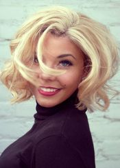Try a Marilyn Monroe inspired look with a short curled bob and red lips!