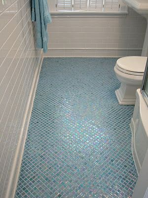 Small mosaic tiled floor with custom colored grout. Watery effect. Subway tiled walls, tiled base.