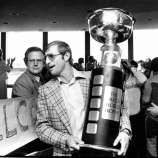 Houston Aeros left wing Ted Taylor carries the World Hockey Association AVCO 1975 World Trophy