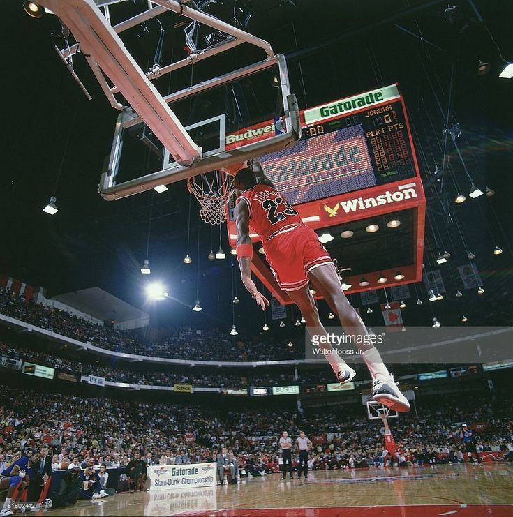 NBA Slam Dunk Contest, Chicago Bulls Michael Jordan (23) in action, making dunk during All Star Weekend, View of scoreboard at Chicago Stadium, Chicago, IL 2/6/1988