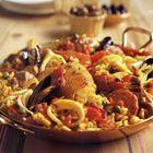 Een heerlijk recept: Paella met schaal- en schelpdieren en gemengd vlees