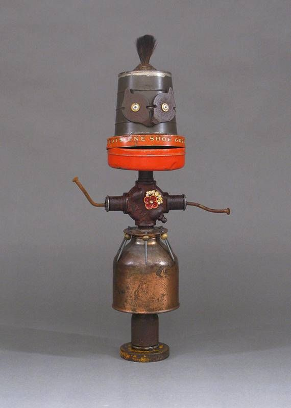 ZARA is a one-of-kind robot sculpture. This whimsical robot sculpture is created from found and discarded objects which include a oil can, tin can, tin measuring cup, paint brush bristles, jewelry pieces, jewelry beads, rusty nails, lamp part, and industrial scrap. Zara is not a