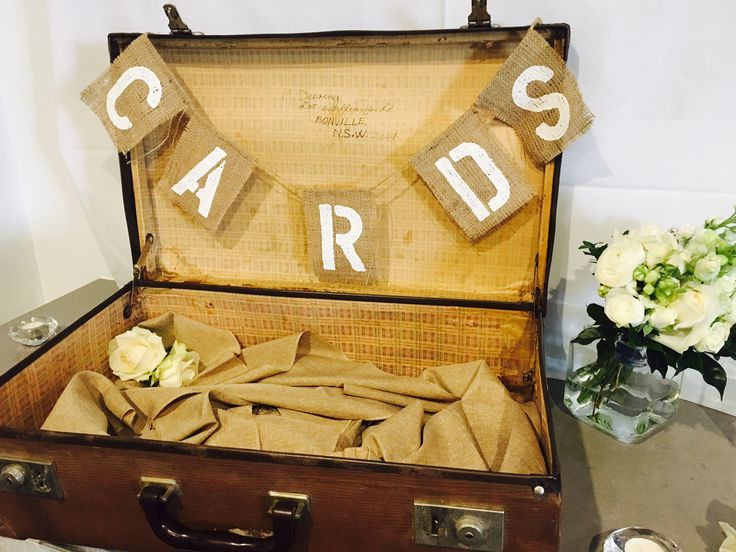 Vintage suit case with card bunting - wedding reception