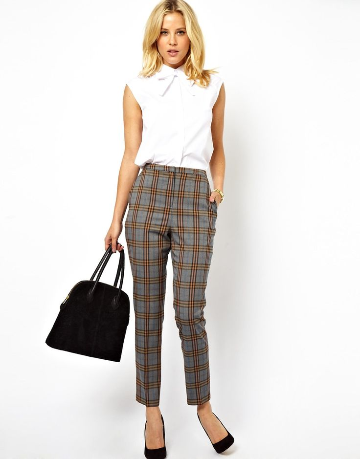 High-waisted plaid pants with solid color top.