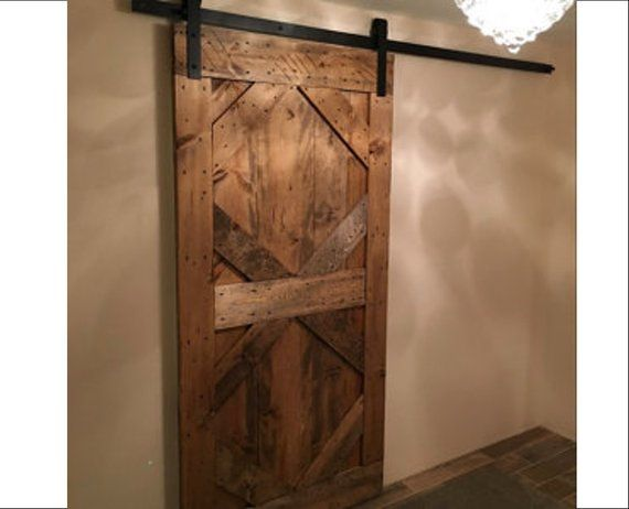 What A Way To Transform A Doorway All Custom Made Sliding Barn Doors For A Rustic Luxurious Look For Your Home Barn Doors Sliding Barn Door Rustic Barn Door