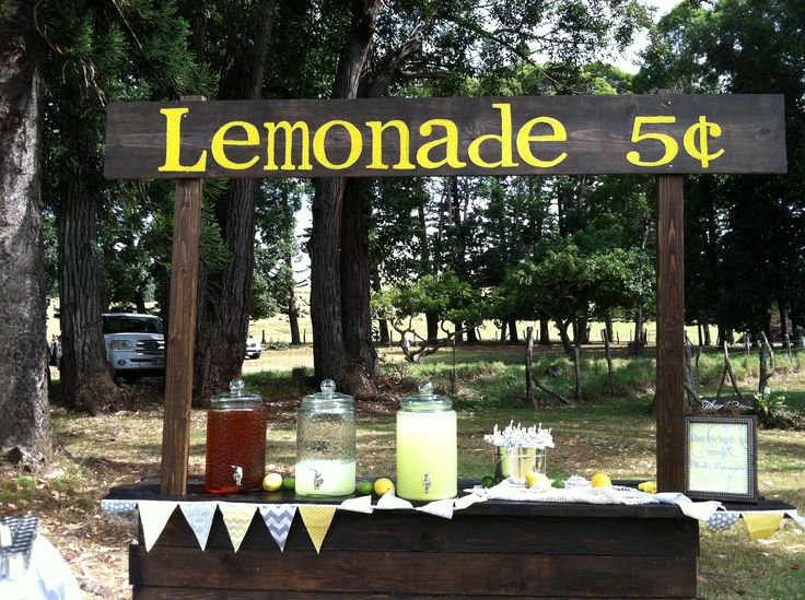 Homemade lemonade stand at a yellow and gray country for Rustic lemonade stand